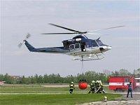 Odlet vrtulníku s plným bambi vakem. Foto Pavel Nehybka.
