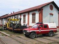 Požiarny vlak zložený z vozíka MUV 69 s prívesným vozíkom s nádržou a Toyota Zboru protipožiarnej oc
