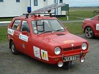 britská hasičská tříkolka, podobná bývala terčem Mini Cooperu Mr.Beana...