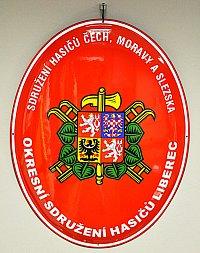 Smaltovaný hasičský ovál s oficiálním znakem SH ČMS a státním znakem