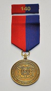 Město Houstoň nechalo zhotovit pamětní medaile za zásluhy členům místního hasičského sboru.